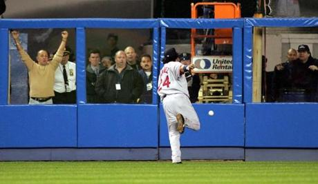 Manny Ramirez couldn't handle this ball off the bat of the Yankees' Bernie Williams in Game 1 of the ALCS. New York went on to a 10-7 victory.