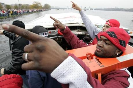 Ortiz, clad with a life vest, interacted with fans as the Red Sox strolled along the river.