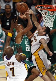 Lamar Odom (left) and Farmar jammed up Allen as he drove to the basket in the first half of Game 5.