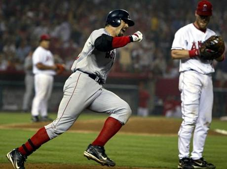 Varitek hit a two-run home run in the sixth inning of ALDS Game 2 that helped power the Red Sox' 8-3 victory.