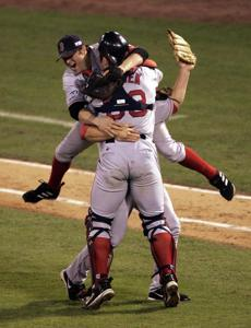 After a groundout by Edgar Renteria, Varitek and Keith Foulke leaped into each others' arms to celebrate the Red Sox' first World Series win since 1918.