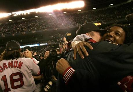 In the celebration, Martinez, right, embraced Schilling, who followed through on his promise a year earlier to deliver a World Series title after being traded from Arizona.
