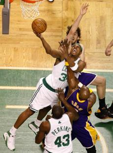 Celtics forward Paul Pierce fights through the L.A. defense for 2 points in the first quarter of Game 1.