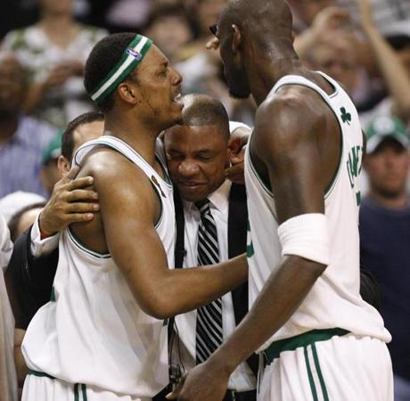 Pierce, left, and Garnett shared a moment with Rivers in the closing minutes of the game.