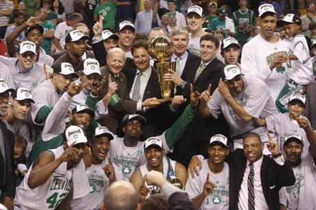 The Celtics gathered for an organizational photo with the trophy after Game 6.