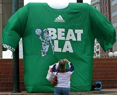 Playoff fever set in around Boston, with a giant T-shirt supporting the Celtics erected at City Hall Plaza.