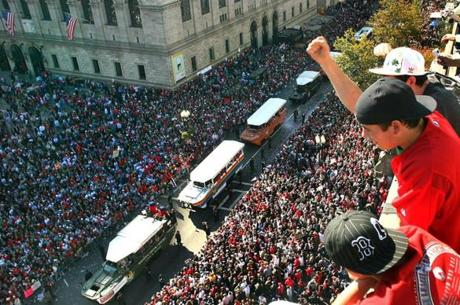 Fans found parade-watching positions high above Boylston Street to take in the scene.