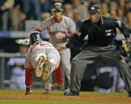Lowell went airborne as he slid in for one of his two runs in Game 4.