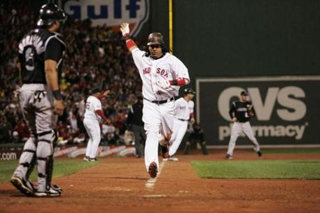 Ramirez trots home for one of the Red Sox' 13 runs in a Game 1 win against the Rockies to start the World Series.