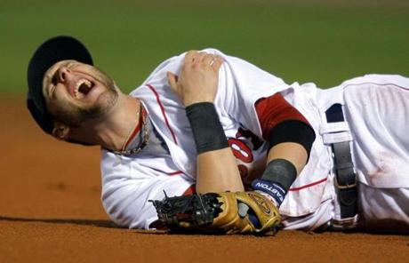 Dustin Pedroia reacted after diving to grab a ball in the ALDS. Pedroia hit just .154 in the series.