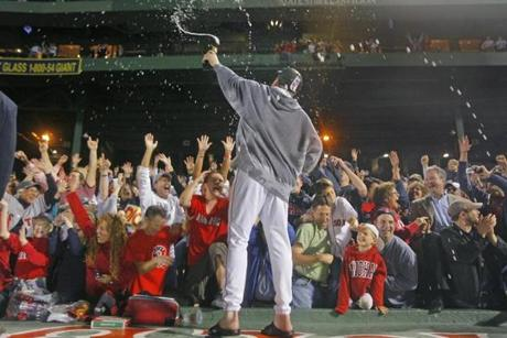 Curt Schilling sprayed jubilant fans with champagne after the Red Sox clinched the 2007 AL East title.