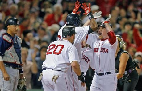 J.D. Drew, right, helped transform the ALCS in the Red Sox' direction with a first-inning grand slam in Game 6 that sparked a 12-2 win,
