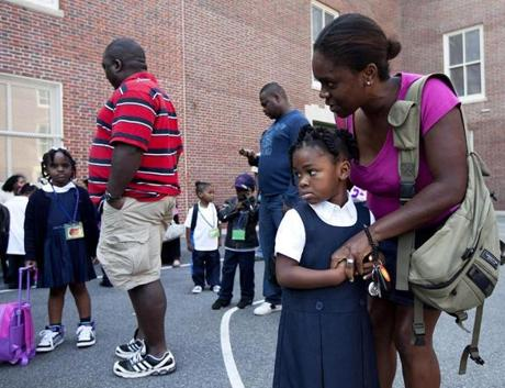 Olayemi Phillips talked to her daughter, Nia, before Nia's first day of school at James J. Chittick Elementary School in Mattapan on Sept. 12.