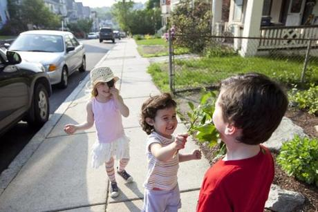 Nora Giarla (rear) is nearing school age, but her mother wonders where to send her.