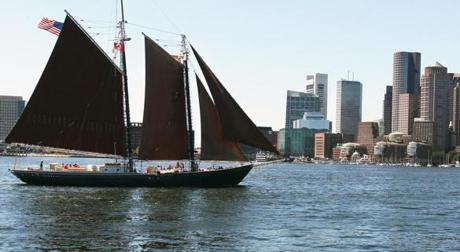 Tom Ryan, skippering the Roseway as it makes its way into         Boston Harbor, Aug. 11, 2011. The 137-foot schooner, which         guided ships into the harbor during World War II, was designated         a national historic landmark in 1997. --