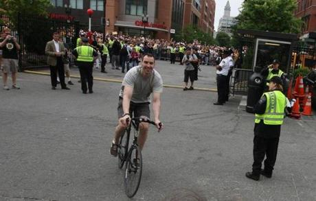 Zdeno Chara, bicycling to TD Garden for the start of the         Stanley Cup parade, June 18, 2011 --