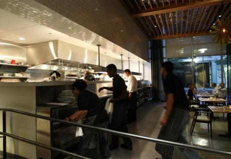 Staff worked in the open kitchen on a recent night.