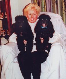 Boston- Catherine Greig with her two poodles. Whitey Bulger