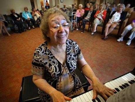 "Naomi Kliman, 82, a resident at NewBridge on the Charles in Dedham who has early-stage Alzheimer's disease, is known as ""the pianist of NewBridge."""