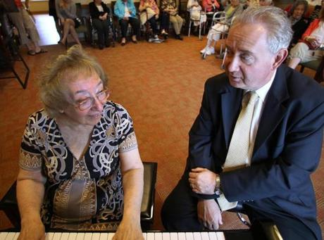 Her son, Burton Kliman, sat with her as she played before her peers.