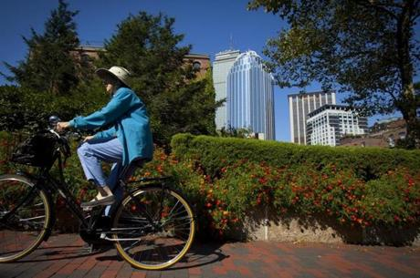 10/09/11 - Boston, MA -A woman rides her bike through Southwest Corridor in Boston park on Sunday, October 9, 2011. The Dartmouth Street entrance to the park is slated for renovation. Story slugged: 11simon. Dina Rudick/Globe Staff.