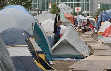 Boston, MA 101111 Tufts University junior Anne Wolfe (cq), left, awoke from her tent as part of Occupy Boston on the Rose Fitzgerald Kennedy Greenway, Tuesday, October 11 2011. (Globe Staff Photo/Wendy Maeda) section: Metro slug: 12occupy reporter: