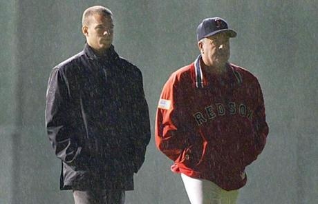 The Red Sox lost to the Yankees in Game 7 of the ALCS in his first season and Epstein would part ways with manager Grady Little, right, after the season.