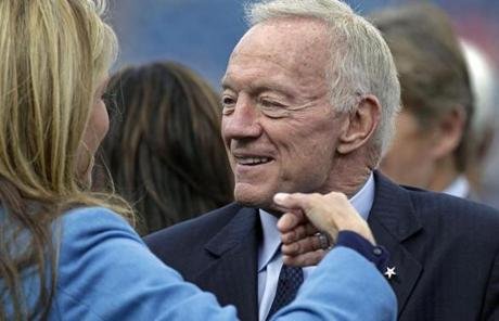 10-16-11 Foxborough, MA: Cowboys team owner Jerry Jones is pictured as he chats with a woman on the sidelines before the game. The New England Patriots hosted the Dallas Cowboys in a regular season NFL game at Gillette Stadium. (Globe Staff Photo/Jim Davis) section: sports slug:unlnown