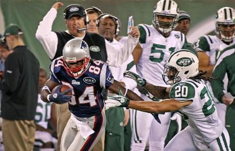 11-13-11: East Rutherford, NJ: Jets head coach Rex Ryan (backround) doesn't like what he sees as Patriots wide reciver Deion Branch beats New York defender Kyle Wilson (20) for a first half first down along the sidelines. The New England Patriots visited the New York Jets in a regular season NFL game at MetLife Stadium. (Globe Staff Photo/Jim Davis) section:sports topic:unknown