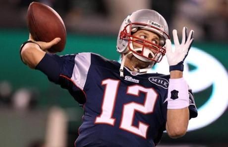 11-13-11: East Rutherford, NJ: Patriots quarterback Tom Brady warms up before the game. The New England Patriots visited the New York Jets in a regular season NFL game at MetLife Stadium. (Globe Staff Photo/Jim Davis) section:sports topic:unknown