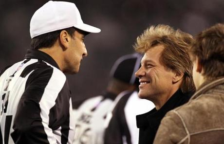 11-13-11: East Rutherford, NJ: Singer Jon BonJovi (right) chats with referee Gene Steratore (left) on the sidelines before the game. The New England Patriots visited the New York Jets in a regular season NFL game at MetLife Stadium. (Globe Staff Photo/Jim Davis) section:sports topic:unknown