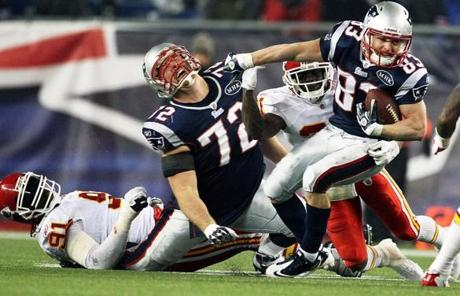11-21-11: Foxborough, MA: Patriots tackle Matt Light screams in pain as it appears that his right leg has been landed on by the Chiefs Tamba Hall in the fourth quarter as Wes Welker heads upfield for some YAC. Light was helped off the field after the play. The New England Patriots hosted the Kansas City Chiefs in a Monday Night Football NFL regular season game at Gillette Stadium. (Globe Staff Photo/Jim Davis) section:sports topic:patriots