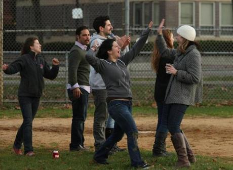 "Teammates high-five after scoring a run in the kickball game. During their time in the park, guests also play cornhole toss and Kirsten ""Kitty"" Amman, a founder of Ladies United for the Preservation of Endangered Cocktails, leads a yoga class. ""We fell in the mud, drank, and ate. It was a sick turnout,"" Bissonnette says. ""I bounced to and from the apartment, cooking and prepping. I love cooking at home for friends."""