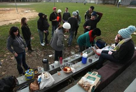 "The group gathers at the Northeastern University fields off Columbus Avenue for games and appetizers before dinner at Bissonnette's South End home. The chef prepares Thai sausage hot dogs (pictured), another provides squash soup, and guests shuck oysters. They pass mulled cider, flasks of bourbon, and Fernet Branca. The tradition began when Bissonnette left Eastern Standard, where he had worked on Thanksgiving, and suddenly found himself with a holiday. ""What started small ended in 28 people sitting on beds, chairs, floors. A 600-square-foot apartment covered in gravy, broken glass, and joy,"" he says. ""The following year, we had to do it again."""