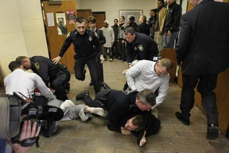 A scuffle broke out in Quincy District Court as several teenagers were arraigned in the murder of Kyle McManus.