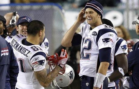 Tom Brady and Aaron Hernandez shared a laugh late in the fourth quarter, as the Patriots dominated the Eagles Sunday, 38-20,