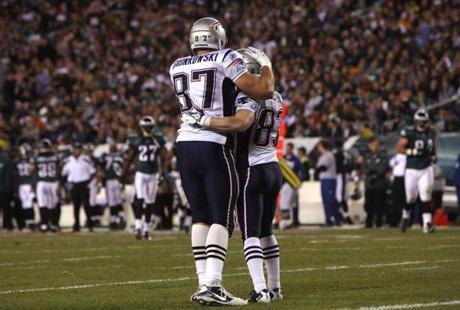 New England Patriots tight end Rob Gronkowski (87) congratulated wide receiver Wes Welker (83) after he scored a touchdown during the second quarter against the Philadelphia Eagles at Lincoln Financial Field.