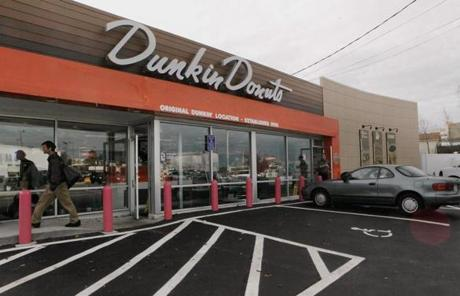The original Dunkin Donuts location in Quincy has been remodeled with a retro look.
