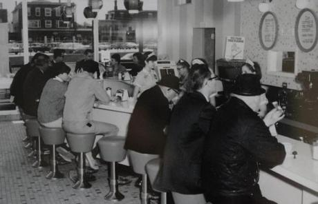 The newly renovated space brought back the horseshoe counter with stools, pictured here in the '70s.
