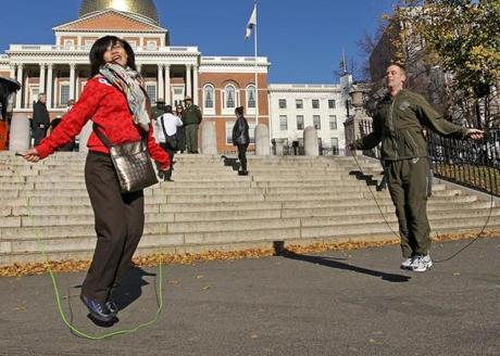 Xue Fon Yang, a tourist from China, jumped rope with US Marine Sergeant Patrick Harrington on Boston Common across from the State House.