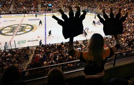 "Caroline Brady, 9, of Concord, on the offense at the         Bruins-Red Wings game at TD Garden on Nov. 25, 2011. Said Brady,         ""I go to a lot of Bruins games. I was cheering them on because         their mascot is a bear. My aunt surprised me with these new         Bruins claws and I thought, 'Wow, maybe I can get on the big         screen, 'cause I could actually look like a bear.' That was my         goal. I was screaming, 'Go Bruins.' I was trying to get their         attention. I was thinking that I love the Bruins and that it is         really fun here. I thought the Red Wings were annoying. I think         they would hate me because I was cheering for the Bruins. When I         finally got on, it was like, 'Wow, there's my big face and I         actually got on the big screen.' It was huge. My friends were         like, 'Whoa, you actually did it.'''"