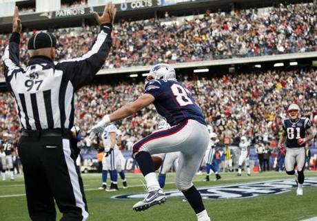 FOR SPORTS. Foxborough, MA 12/4/2011 Patriots' TE Rob Gronkowski #87 celebrates his 2nd quarter touchdown by spiking the ball. The New England Patriots play the Indianapolis Colts at Gillette Stadium, in week 13 of the NFL regular season, in Foxborough, MA on Sunday, December 4, 2011. (Yoon S. Byun/Globe Staff) Section: SPORTS Slug: patriots Reporter: manza young LOID: 5.0.606618733