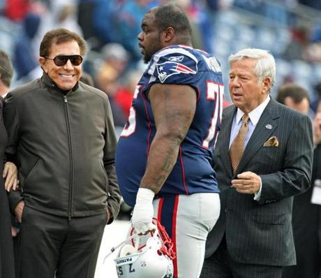 12-04-11: Foxboro, MA: Gambling magnate Steve Wynn (second from left) smiles as he watches Patriots DL Vince Wilfork walk by him as he leaves the field following pre game warmups. His host, Patriots owner Robert Kraft is at right. The New England Patriots hosted the Indianapolis Colts in an NFL regular season game at Gillette Stadium. (Globe Staff Photo/Jim Davis) section:metro topic:patriots