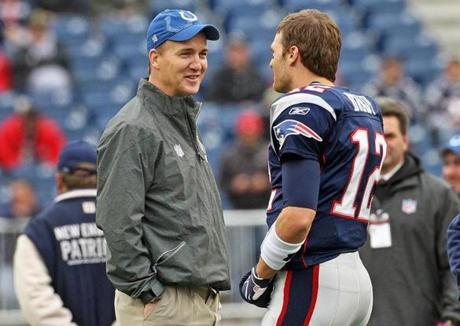 12-04-11: Foxboro, MA: Injured Colts quarterback Peyton Maning chats with Patriots quarterback Tom Brady on the field before the game. The New England Patriots hosted the Indianapolis Colts in an NFL regular season game at Gillette Stadium. (Globe Staff Photo/Jim Davis) section:metro topic:patriots