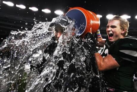 Foxborough-December 1, 2011-Globe Staff photo by Stan         Grossfeld----------Duxbury coach Dave Maimaron gets doused with         ice cold water by outside linebacker Ron Kosharek, a junior,         after concluding his team's second consecutive undefeated season         and a 35-0 victory over Tewksbury in the Super Bowl held at         Gillette Stadium.