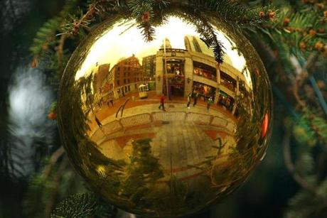 Boston, Mass. -12/20/11- A large ornament on the Christmas tree at the Faneuil Hall Marketplace reflects passersby and the surrounding building. Boston Globe staff photo by John Tlumacki (metro)