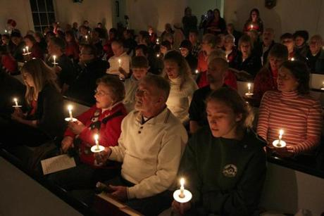 Stockbridge, VT - 12-18-11- Candles are held during the annual Christmas Pageant at the Stckbridge Meeting House. (Globe staff photo / Bill Greene) section:met, reporter:filipov, topic:25irene