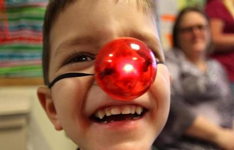 Boston, Mass. -12/20/11- Members of the Boston Bruins visited with pediatric patients at the Spaulding Rehab Hospital where they handed out presents, posed for photos an ddid syringe painting with the kids. Nathan Cariker(cq), 6 from Attleboro was give a lighted Rudolph nose by Andrew Ference. Boston Globe staff photo by John Tlumacki (lifestyle)