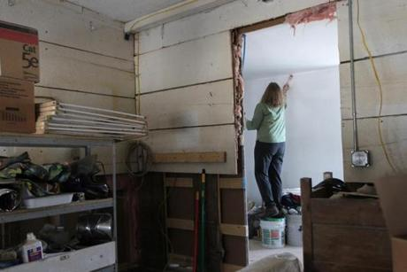 Stockbridge, VT - 12-18-11- Connie Mendell (cq) of Rochester paints her daughters home which was damaged during the floods of Tropical Storm Irene. (Globe staff photo / Bill Greene) section:met, reporter:filipov, topic:25irene