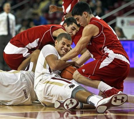 12-21-11: Chestnut Hill, MA: BC's Ryan Anderson (center) battles with Sacred Heart's Justin Swidowski (left) and Phil Gaetano (right) for a second half loose ball. The Boston College men's basketball team hosted Sacred Heart at Conte Forum. (Globe Staff Photo/Jim Davis) section:sports topic: BC-Sacred Heart